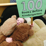 stuffed animal and girl who read 100 books