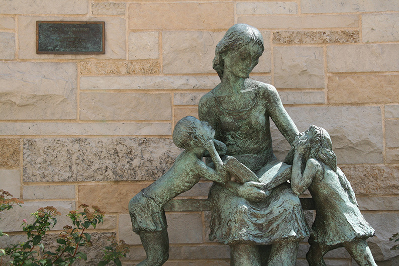 Once Upon a Time Sculpture of mother reading to two children