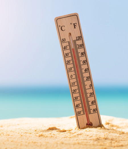 Closeup Of Thermometer On Sand Showing High Temperature