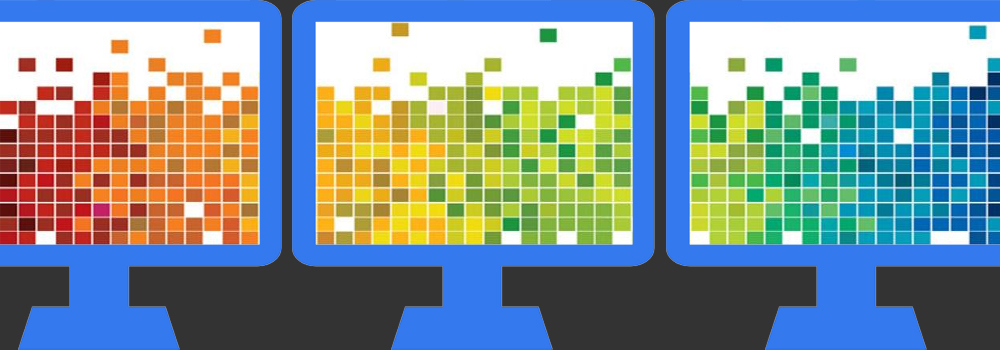 Creative Studio Comptuers with rainbow pixels on the desktop