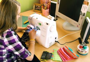 Girl at sewing machine