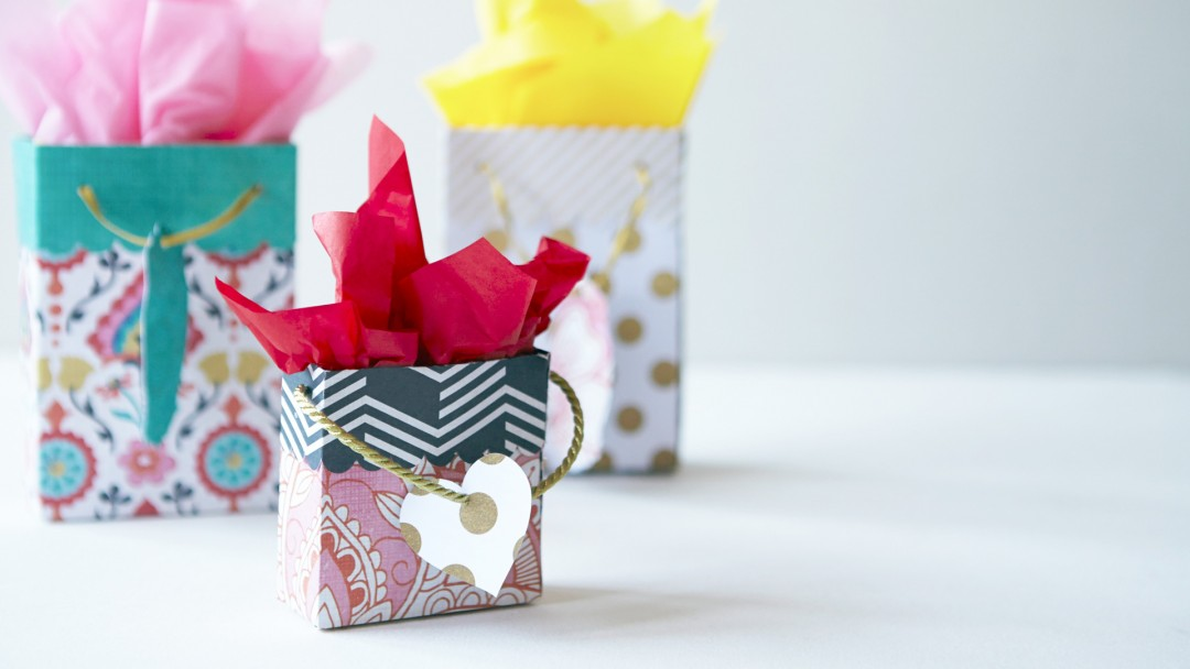 paper gift bags with colorful tissue